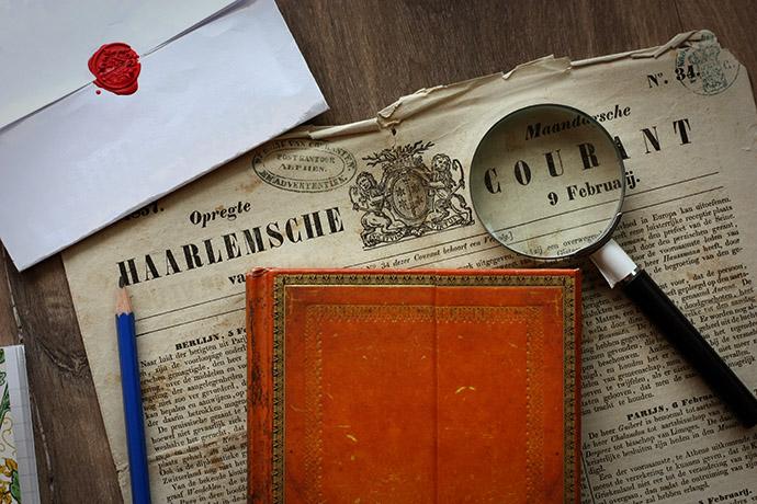 krant-1857-voorpagina-loep