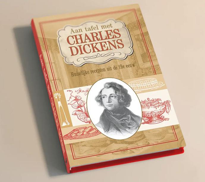kookboek aan tafel met charles dickens