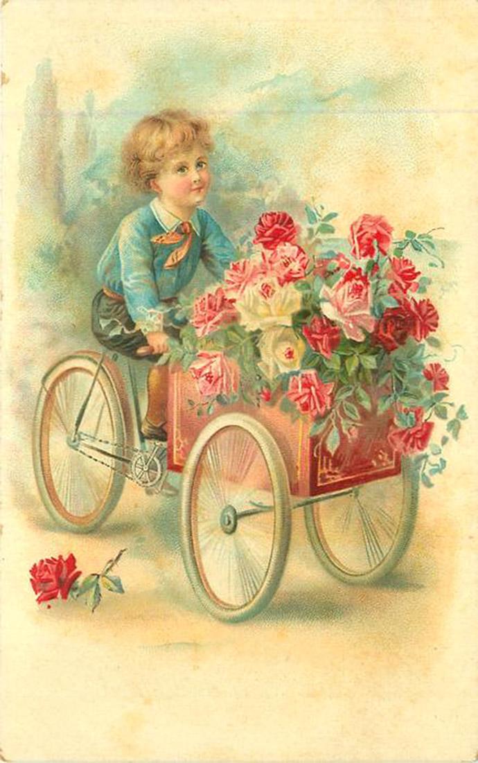 Een klassieke wenskaart voor verjaardagen met jongetje met een bakfiets vol rozen, uit 1904 uitgegeven door de Raphael Tuck & Sons